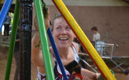 A Projects Abroad construction volunteer in Ghana painting a playground.